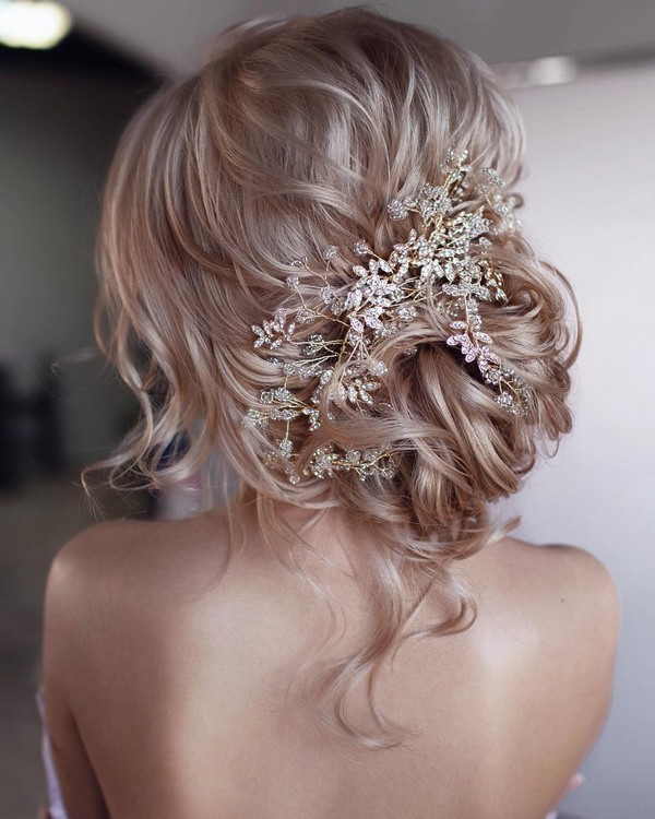 pretty and messy updo wedding hairstyle with headpiece