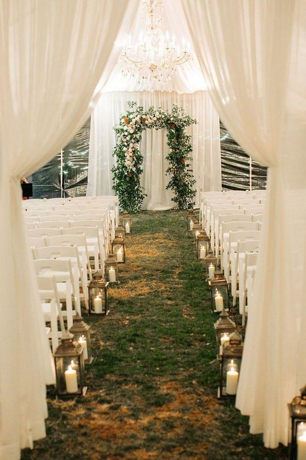 romantic wedding ceremony decoration ideas with lantern aisle and draped fabric