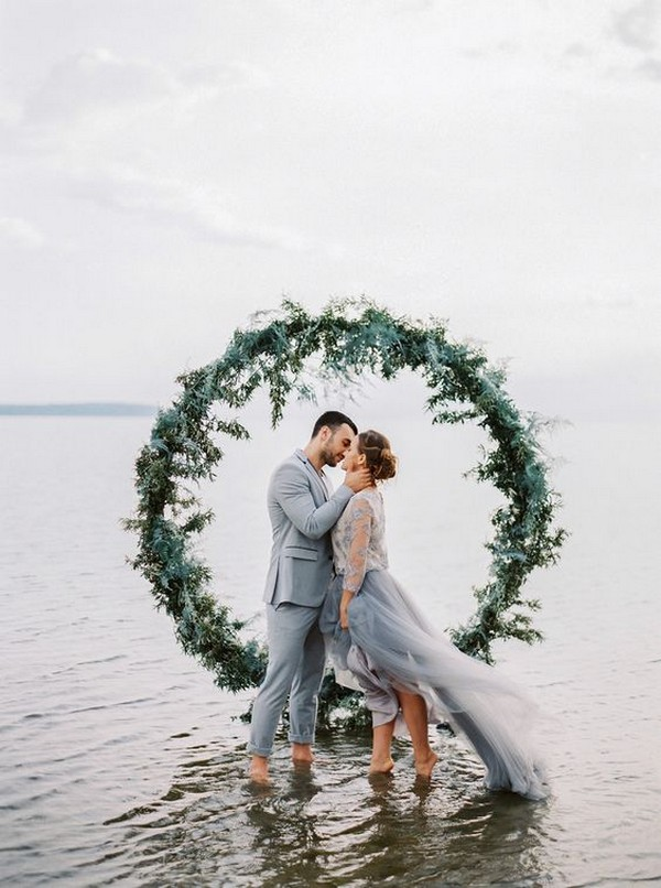 romantic wedding photo with greenery circular wedding backdrop