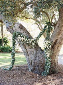 simple diy wedding ceremony arch with garland