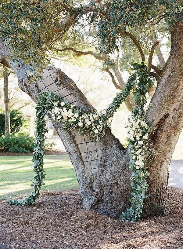 simple diy wedding ceremony arch with garland