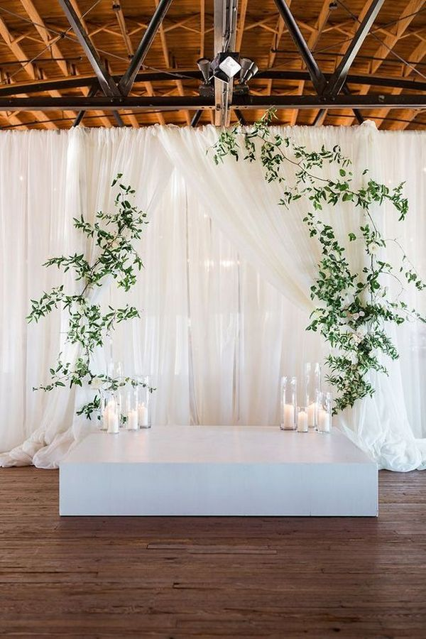 simple elegant wedding backdrop ideas with greenery and white drapery