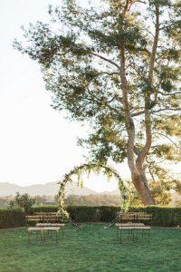 vineyard simple wedding ceremony ideas with circular wedding arch