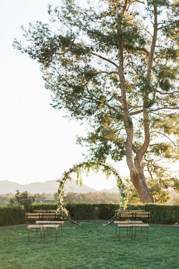 vineyard simple wedding ceremony ideas with circular wedding arch