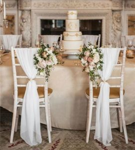 vintage wedding chair decoration with floral fabric and pearls