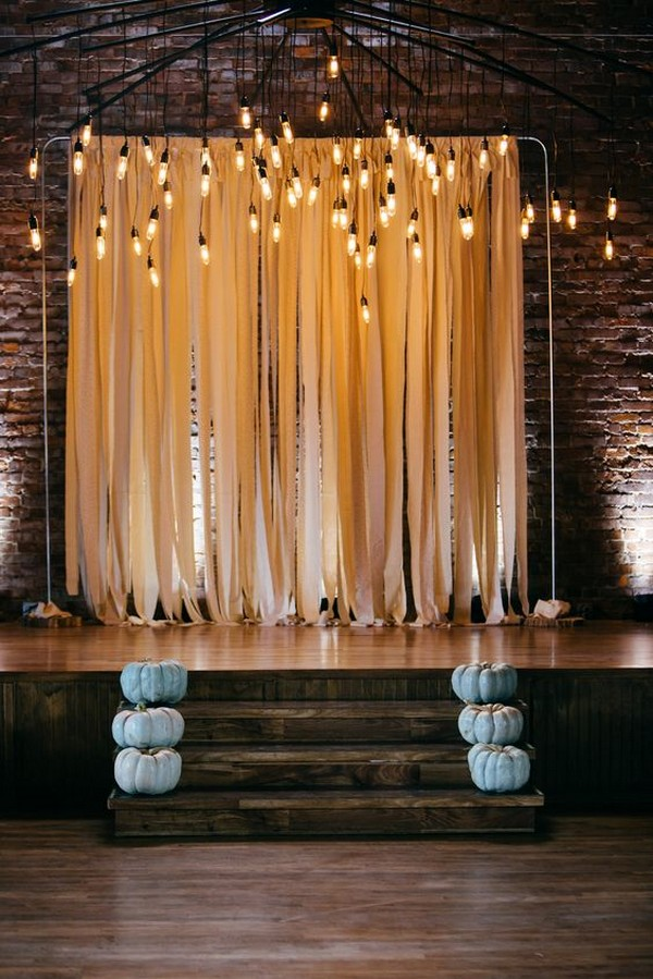 Wedding Ceremony With Ribbon Backdrop And Edison Bulbs