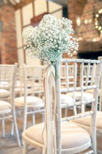 wedding chair decoration ideas with baby's breath and ribbons