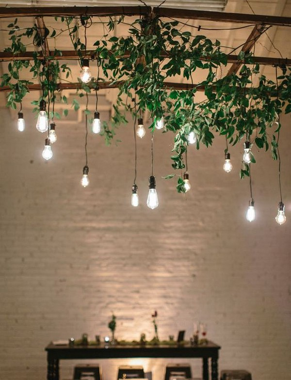 wedding decoration ideas with hanging greenery and Edison bulbs