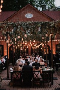 wedding reception ideas with hanging greenery and Edison Bulbs
