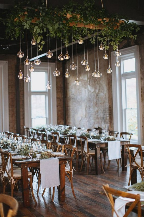 chic loft wedding reception with hanging candles