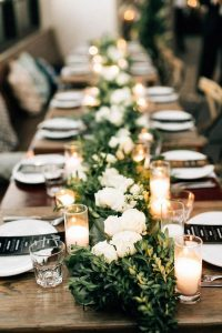 chic long wedding table runner ideas with greenery and candles