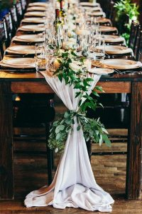 chic wedding table settings with drapery table runner