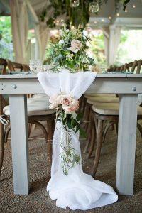 elegant white wedding table runner with flowers
