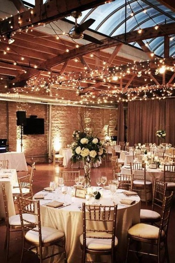 indoor loft wedding reception with twinkly lights