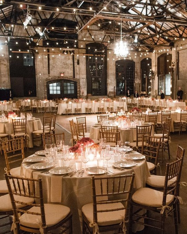 industrial loft style wedding reception with string lights
