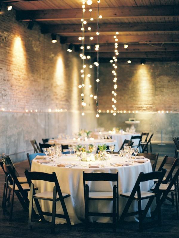 loft wedding reception decorations with string lights