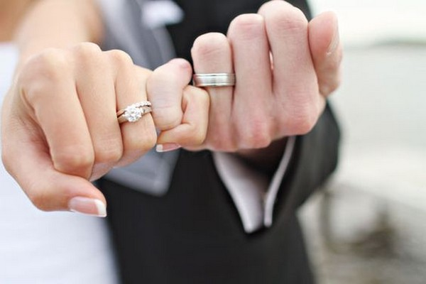 pinky promise bride and groom wedding photo