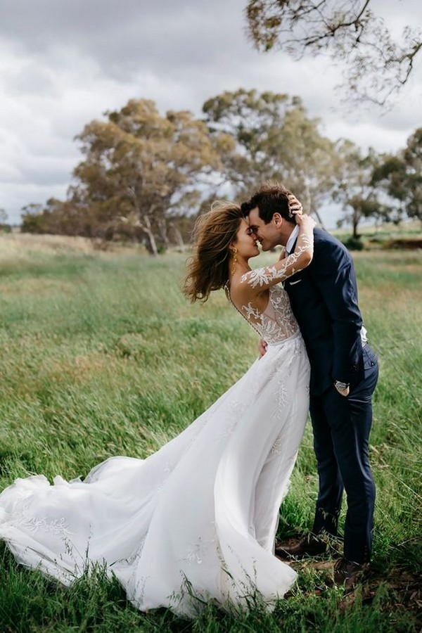 romantic windswept bride and groom wedding photo ideas