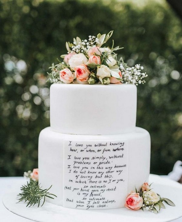 white wedding cake with hand written love quotes