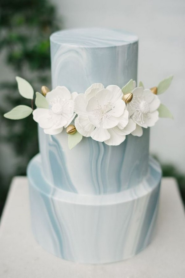 Blue and white marble wedding cake with white flowers