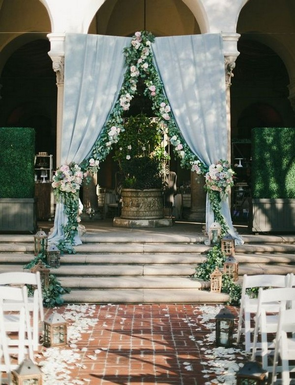 Dusty blue and greenery eucalyptus wedding arch