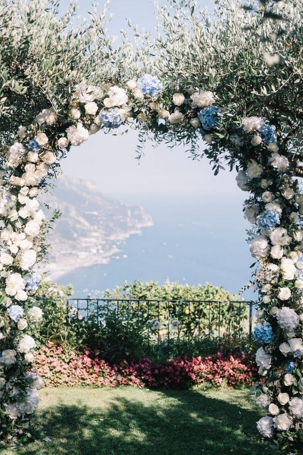 blue and white floral wedding arch