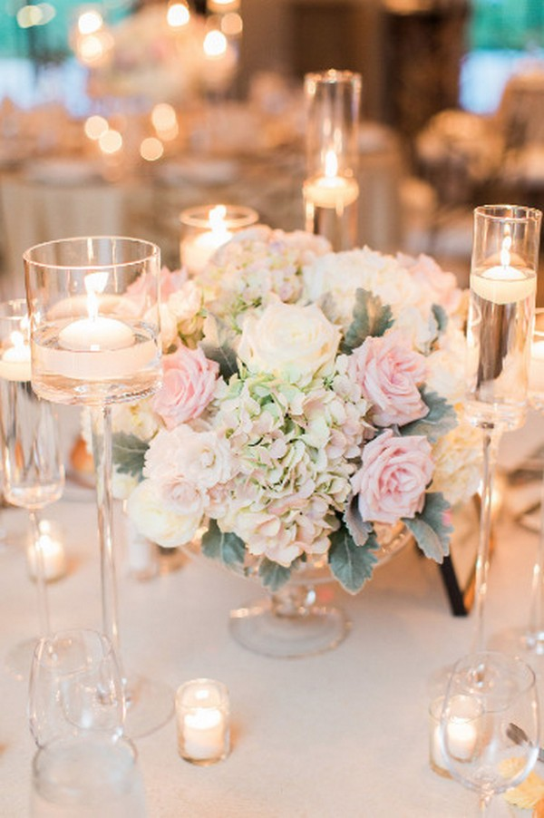 blush and ivory wedding centerpiece with floating candles