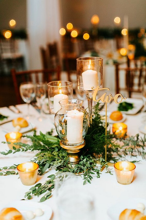 gold and greenery wedding centerpiece ideas with calligraphy table number
