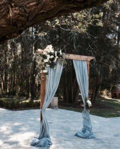 rustic chic dusty blue wedding arch