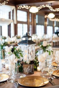 vintage lantern wedding centerpiece with wood table number