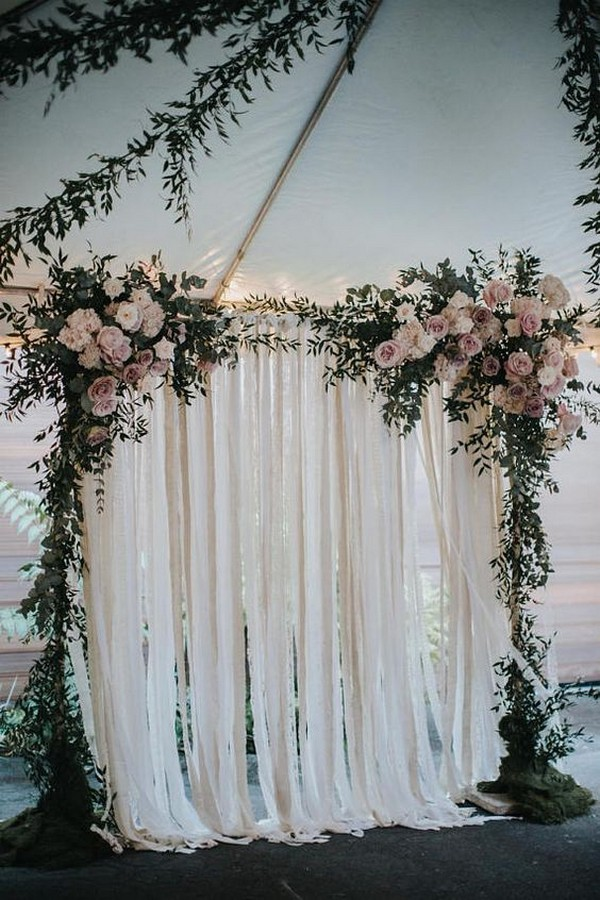 blush pink floral decorated wedding arch