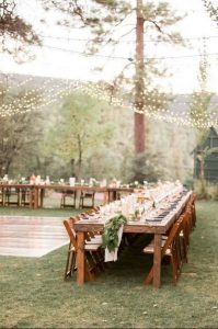 boho chic outdoor wedding reception with string lights