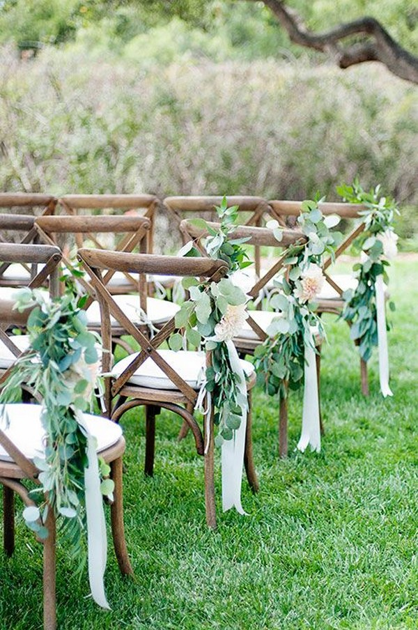chic outdoor wedding aisle ideas with greenery and ribbons