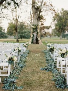 chic outdoor wedding ceremony ideas with greenery aisle