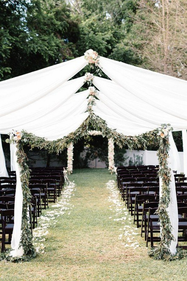 chic outdoor wedding ceremony ideas with white fabric and greenery arches