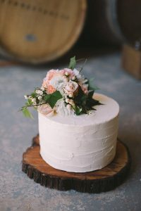 chic single layer wedding cake with tree stump stand