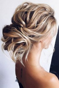 curly messy low bun wedding hairstyle