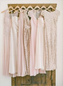 mismatched pink and glitter gold bridesmaid dresses