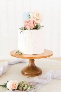 modern elegant one tier wedding cake with pink floral