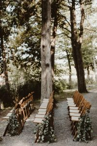 outdoor wedding aisle decoration ideas with draped greenery