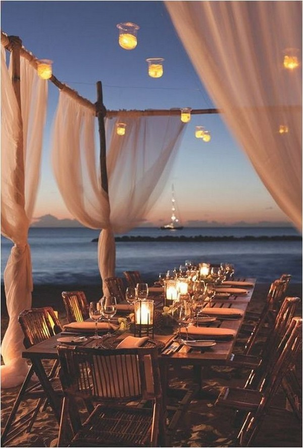 romantic beach night wedding reception with lights
