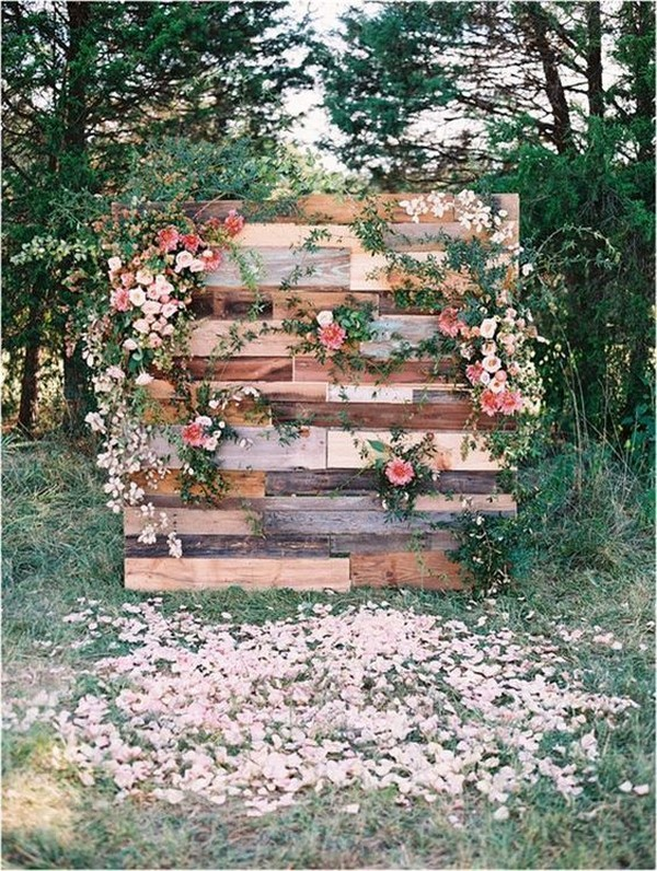rustic wooden wedding backdrop with floral