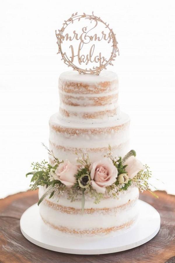 semi naked wedding cake with blush pink floral
