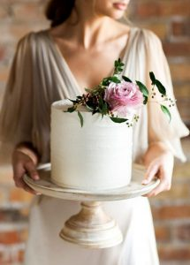 simple elegant single layer wedding cake with floral