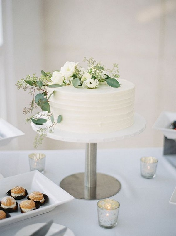 simple elegant white and greenery wedding cake