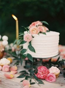simple one tier wedding cake with pink floral