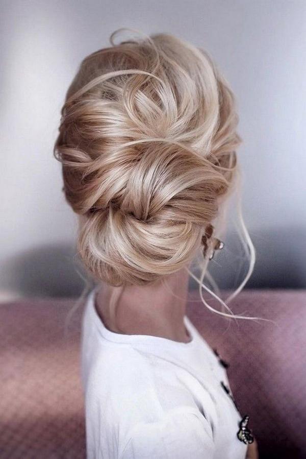 trending messy updo wedding bridal hairstyle