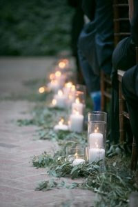 wedding ceremony aisle with branches and candles