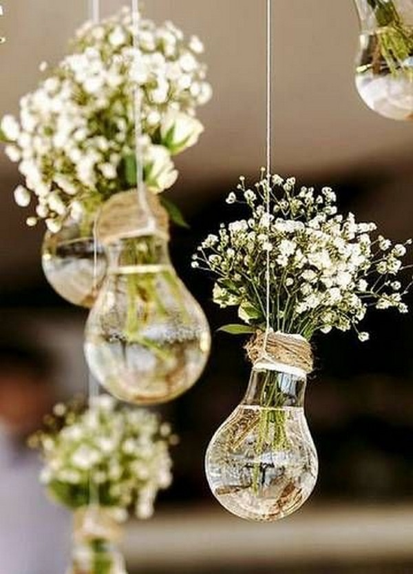 wedding decorations with hanging Edison bulbs and baby's breath
