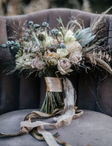 blue and neutral boho wedding bouquet